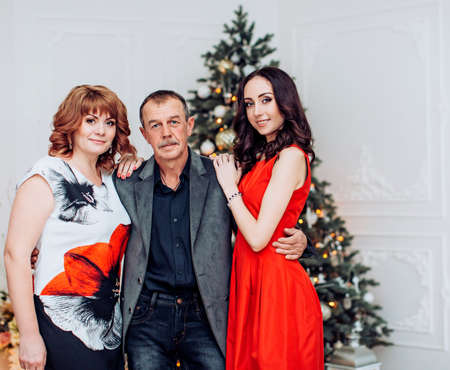 Beautiful family with a grown-up daughter waiting for Christmas