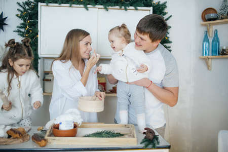 Big happy family baking with little daughters on a kitchen Reklamní fotografie