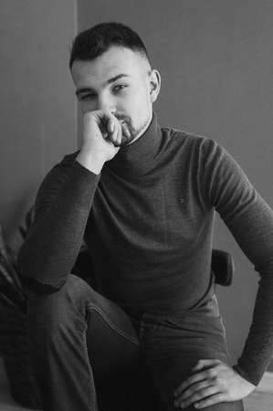 Beautiful man on a dark gray background