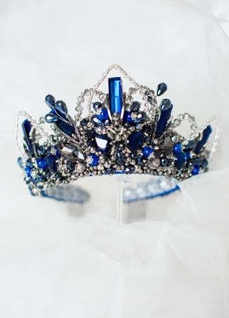 Beautiful blue crown on a gray background for the design Imagens