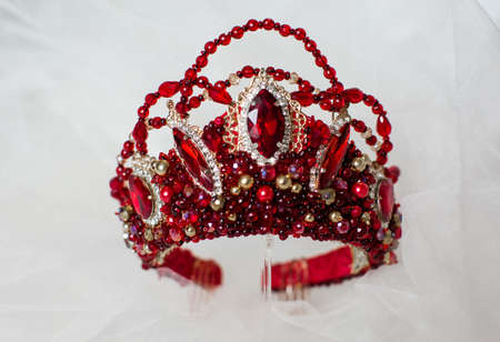 Beautiful red crown on a gray background for the design
