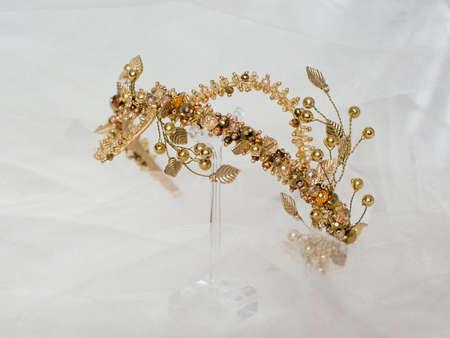 Beautiful gold crown on a gray background for the design