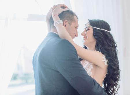 Happy bride and groom on their wedding Standard-Bild - 115800409