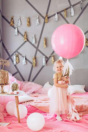 Beautiful little girl celebrating birthday party. Family celebration of the child Stock Photo