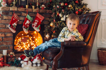 Portrait of a boy playing near the Christmas tree Imagens - 114763431