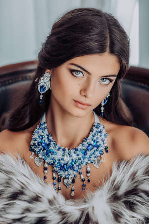 Portrait of beautiful young brunette woman with makeup Imagens