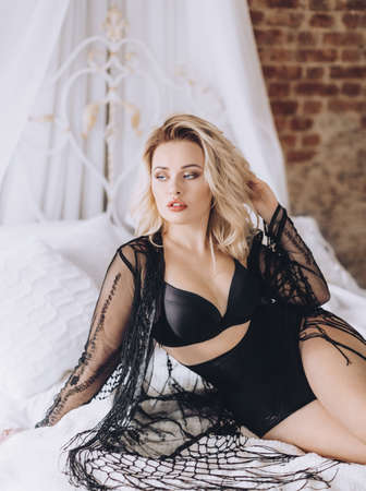 Sexy beautiful blonde woman in black underclothes Stockfoto