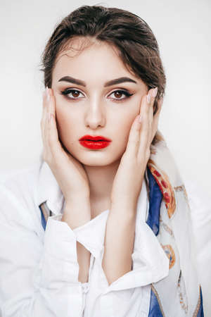 Portrait of beautiful brunette girl with makeup