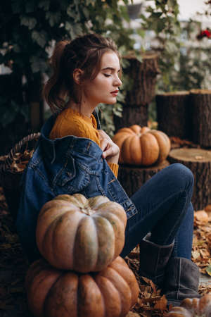 Portrait beautiful girl in autumn garden