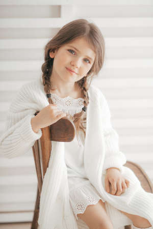 Portrait of beautiful little girl with pigtails