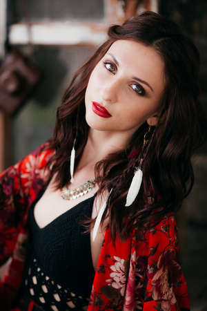 Portrait of beautiful young brunette woman with makeup in bright clothing