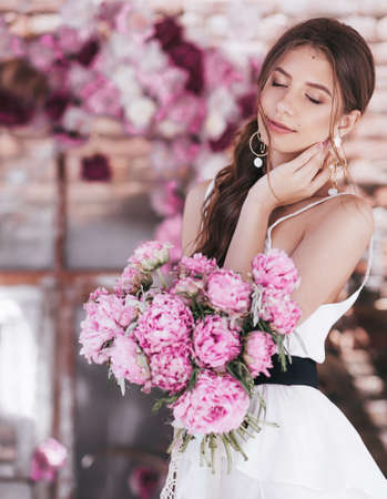 Portrait of beautiful girl in white dress with pink pi-mesons