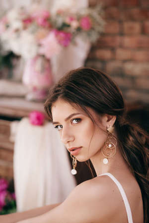 Portrait of beautiful girl in white dress with pink pi-mesons Stock Photo