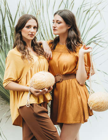 Portrait of two young beautiful women with melon Stockfoto