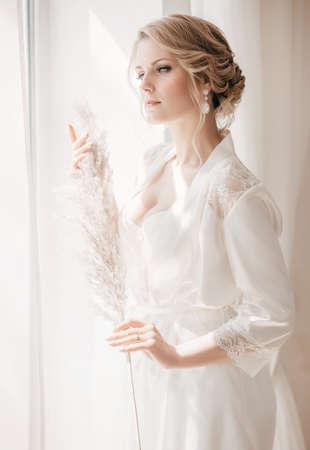 Beautiful blonde bride with stylish make-up