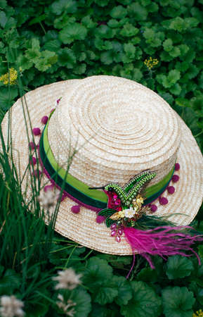 Beautiful straw hat decorated with a brooch