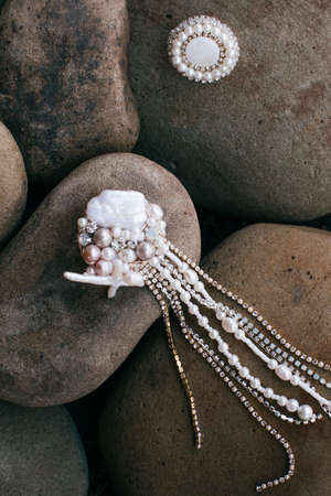 Beautiful stud earrings on the stone