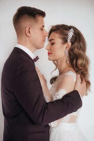 Stock Photo - Portrait of beautiful young wedding couple