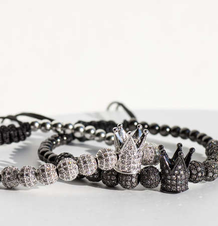 Stock Photo - bracelet with little crown on white