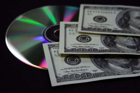 laundered: CASH WITH CD DVD