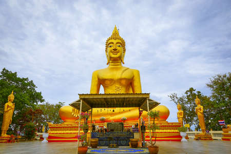 Smile Big Buddha at Pattaya,Sign at Center is chapter pray of Budishm,Sign on the right is The name of Big Budhha
