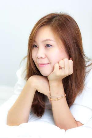 Beautiful Thai woman with long straight hair