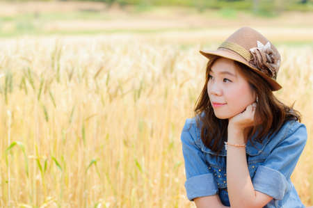 Image of woman on wheat field