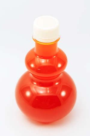 orange juice in bottle isolate on background