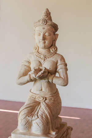 aukana buddha: statue of woman isolate on background