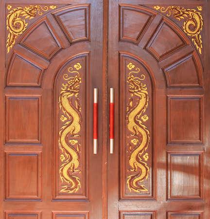 golden dragon decorated on  wood door