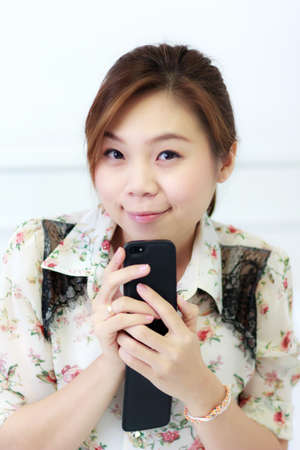 Portrait of a beautiful female model with smart phone Stock Photo
