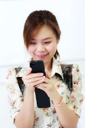 Portrait of beautiful female with smart phone