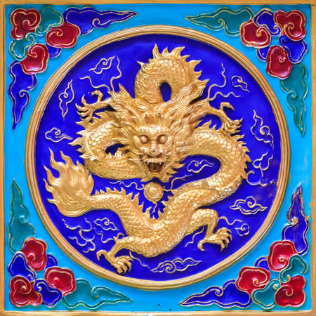 golden dragon decorated on wall Stock Photo
