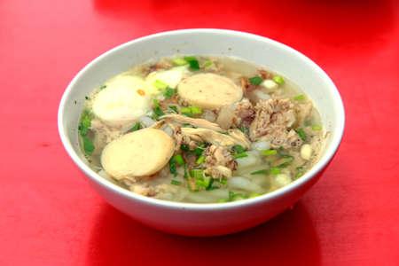 Chicken Porridge served on red table
