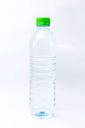 a plastic bottle of mineral water on white background