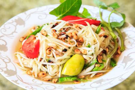 Thai papaya salad served on dish