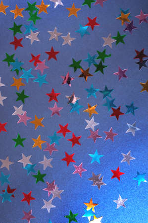 Festive colorful stars background. Christmas abstract flat-lay. Stock fotó