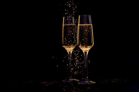 Glasses of champagne with black background and lights