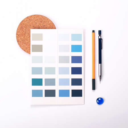Shades of trending blue color swatches on white background with stationery. Flat lay for interior design. Color swatch mockup. Stock fotó