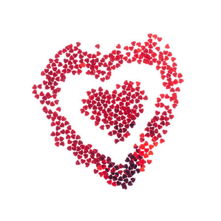 Red textured heart made of heart forme sparkles on white background. Valentines day concept card. Stock fotó
