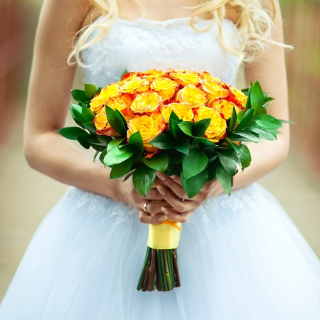 Wedding bouquet of roses held by a bride  photo