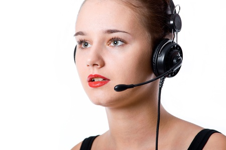 Beautiful call center operator with headset. Isolated over white background Stock Photo - 21648817