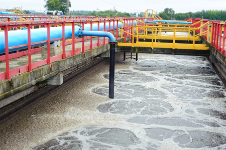 system utility: Water treatment facility with large pools of water Stock Photo