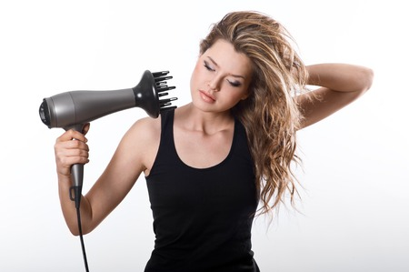 girl dry with hairdryer their long brown hair,  isolated on white background Stock Photo - 22842951