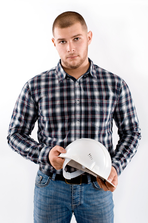 construction worker holding hardhat  isolated on white background photo