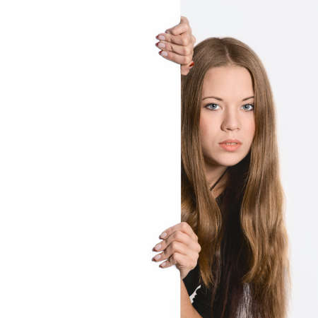 beautiful young woman showing blank signboard, isolated over white background photo