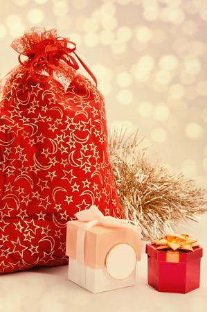 sackful: red Santa Claus sack full of presents and toys on abstract background Stock Photo