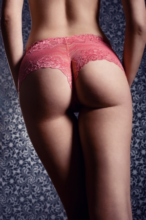 Sexy young woman back with pink lingerie  Perfect slim body photo