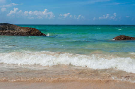 stormy waters: Beautiful beach with crystal clear blue waters of the Andaman sea with waves