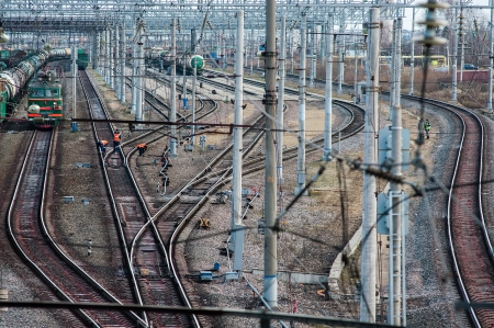 curving lines: Railway station tracks curving. Railroad overhead lines. Stock Photo